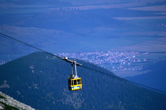 Cable car going up Lomnicky Stit (2633 m), Vysoke Tatry, Slovakia in background.