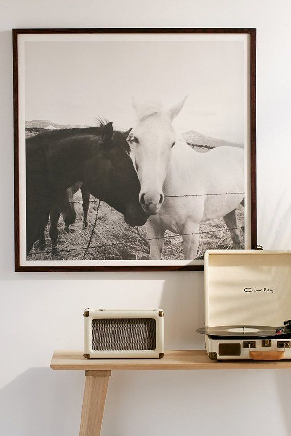 Horse print in front of the record player.