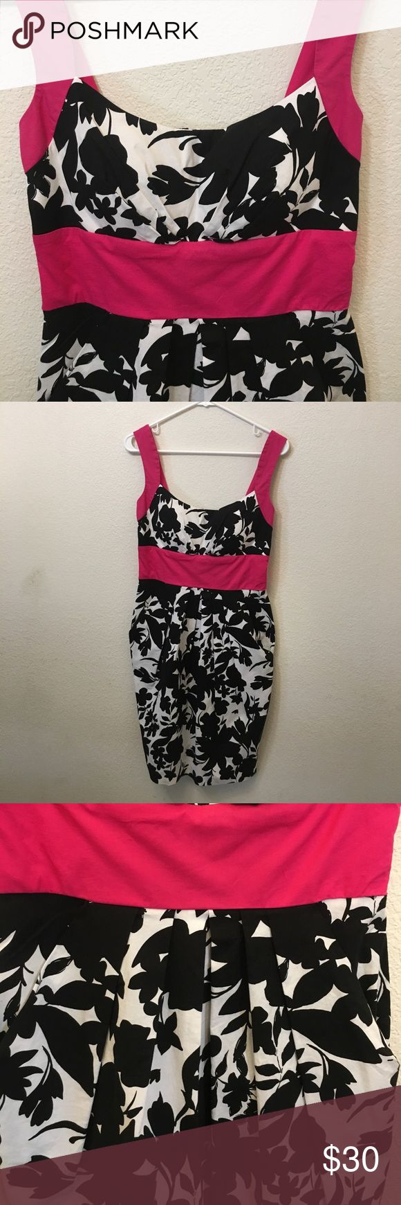 Floral Dress Hot pink, non- adjustable straps with black and white floral print. Has 2 pockets, one on either hip. Zip closure. Non- removable pads.  Straps are about 1 and a half inches thick. It is about 3 feet from top of shoulder to bottom of dress. B. Smart Dresses Mini