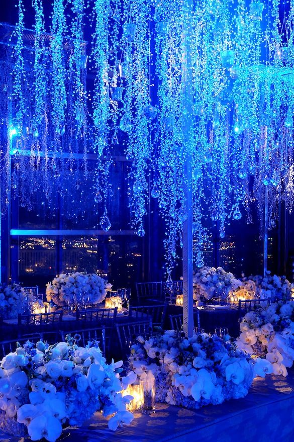 """We love the way icicles capture such a delicate moment.  This concept of an evening being frozen in time brought us to our winter theme for an evening affair. We dripped clear crystals from our tree structure and projected blue lights on them from above.  This gave our icicles an illuminated effect against the dimly lit space."" Preston Bailey: Crystals, Idea, Wedding Receptions, Blue Lights, Winter Wonderland, Winter Wedding, Centerpieces, Blue Wedding"