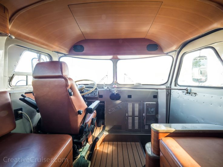 """Restored 1963 Flxible Starliner Vintage Bus known as the Creative Cruiser: The rectangular seam in the ceiling is your only hint that there is a 43"""" 4K HDR drop-down television packed into the ceiling on the bus."""