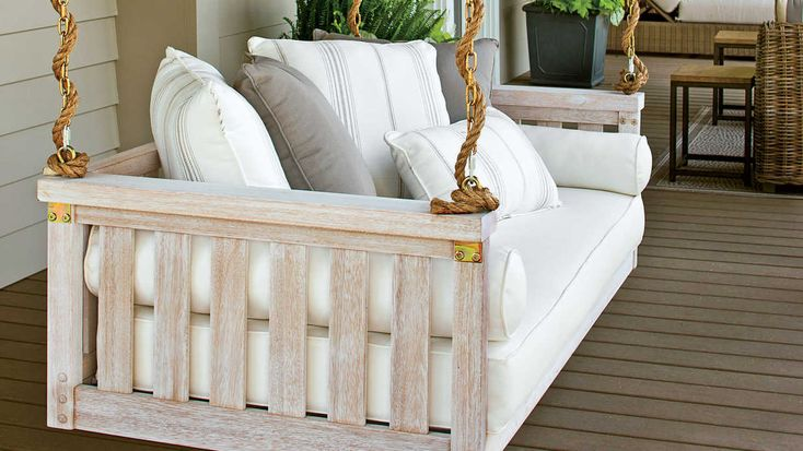 White Farmhouse Porch Swing - Sit a Spell! 10 Peaceful Porch Swings - Southern Living - This plush white porch swing provides extra seating for this spacious