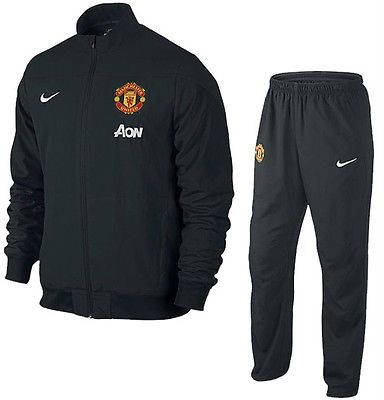NIKE MANCHESTER UNITED SQUAD SIDELINE WOVEN WARM UP SUIT. The Manchester United Squad Sideline Woven Warm-Up Tracksuit delivers the look of the pros with premium team embroidery on both the jacket and