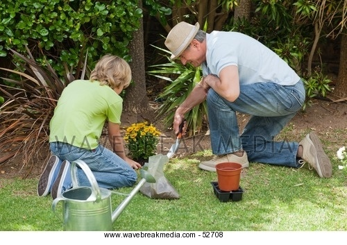 Grandfather with his grandson working in the garden Image by Wavebreak Media