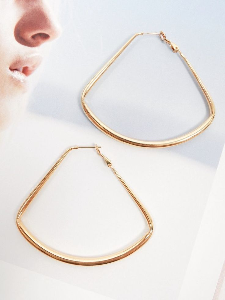 The Get Angles Hoop Earrings feature a curved triangle outline, thick hoop design, and french clip closures.