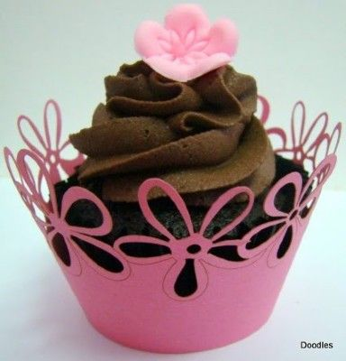 So, I have this fancy machine! If you want these for plants or cupcakes, I can make that happen. The shapes and patterns are endless.   Silhouette Cameo - Cupcake Wrappers