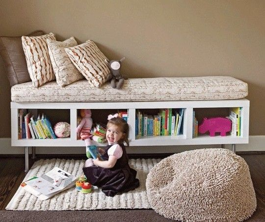Turn a bookshelf on its side, put some legs (or wheels) and a cushion on it, and call it a day! (TONS of great organizational ideas at this site)