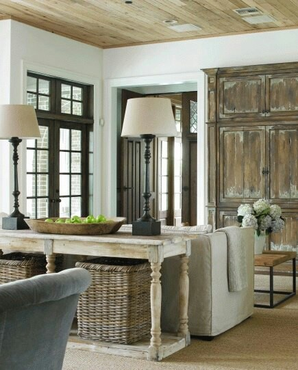 Use old doors as pure decoration if no armoire available.  Also love table behind couch