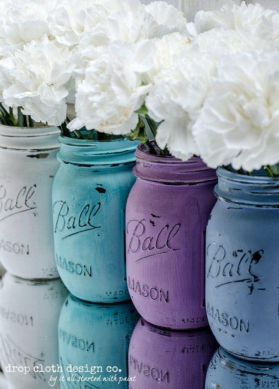 Painted & Distressed Mason Jar - Spring Colors _  Set of 4 mason jars painted and distressed in fun spring colors (white, teal, lavender, blue) colors.