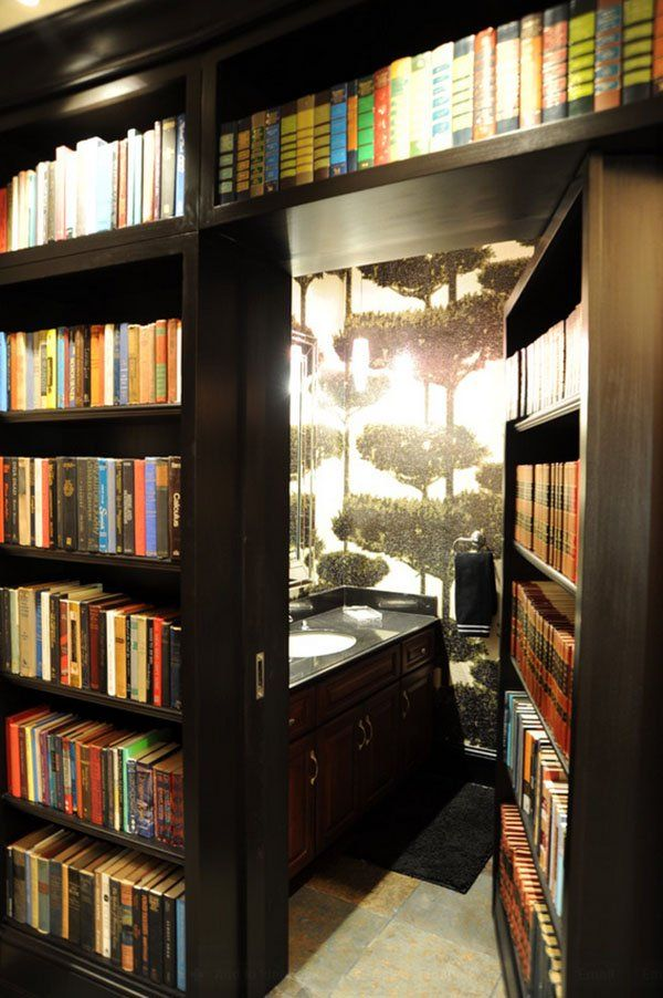 50 Jaw-dropping home library design ideas.  This design is actually very easy to do.  Use a room in your home that has a bedroom just off of it and install (or build) bookshelves on the wall were the bathroom door is.  Change out the bathroom door for a bookshelf.