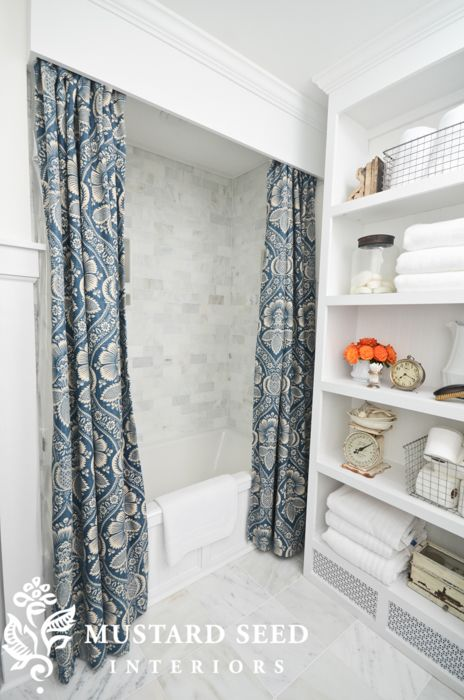 storage space with clever use of space next to the tub that doesn't interfere with the curtain and notice below the heat vent grate - Miss Mustard Seed