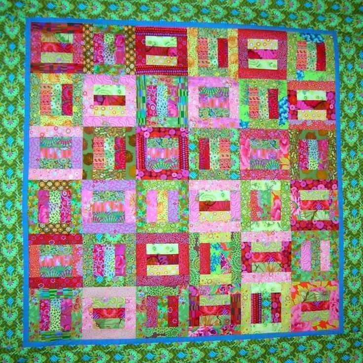 Simply Strips. Made with a Jelly Roll of Kaffe Fassett fabrics. Easy. Quick Done!