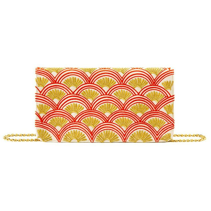 Fan print cotton canvas clutch purse. Gold hardware cross-body chain. Flap with magnetic snap closure. Inner zip pocket.