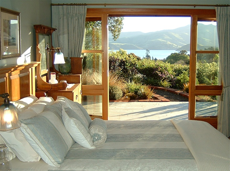 The bedroom of the guest suite overlooking Robinsons Bay, Akaroa Harbour