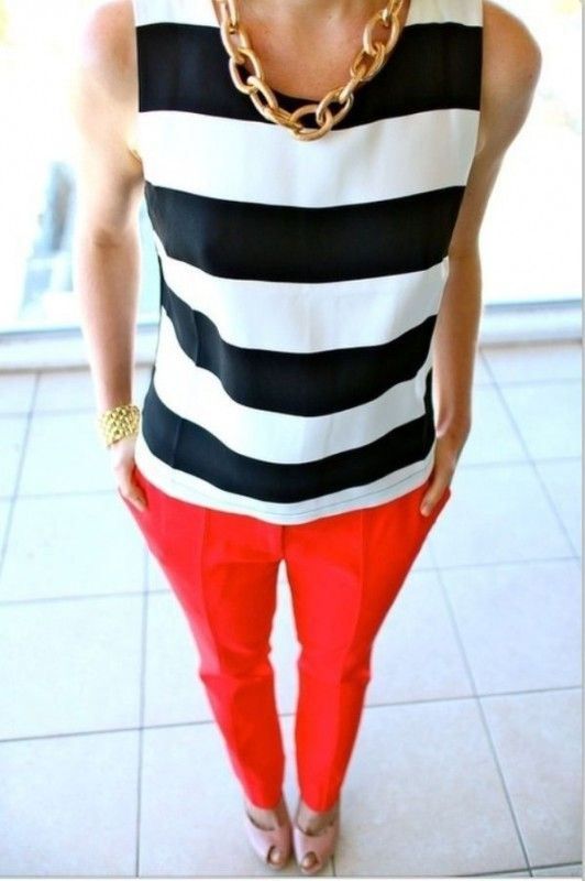 Business casual attire featuring red pants and black and white striped top. Grab a blazer or cardigan in case you want more cover or style options.