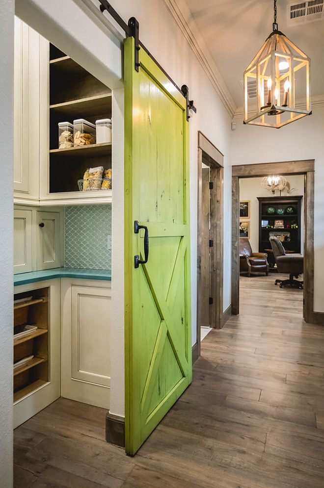 This green barn door paint color is Benjamin Moore Douglas Fir with a charcoal oil base glaze. Butler's pantry with painted barn door in a vibrant green color. | Alicia Zupan