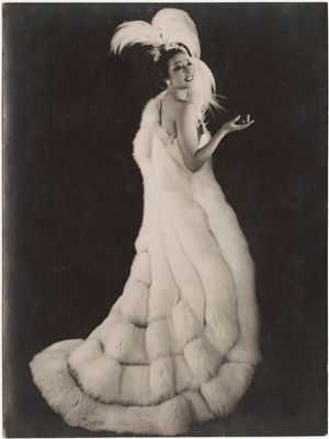 Josephine Baker - LOVE the shape of this coat maybe a different texture but I love the swirl it creates. Especially if there was a completely jewelled and faceted design underneath!