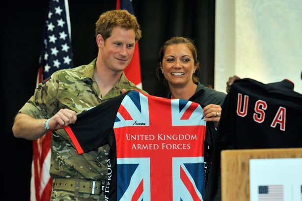 MirrorOnline:  Three-time Olympic Gold Medalst Misty May-Treanor and Prince Harry in Colorado Springs at the Warrior games 5/11/13