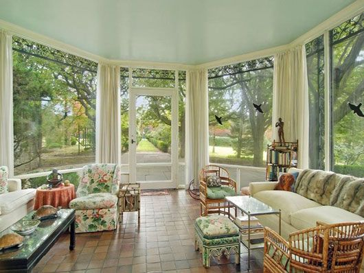 The massive windows provide a breathtaking view of the lush shrubbery outside.