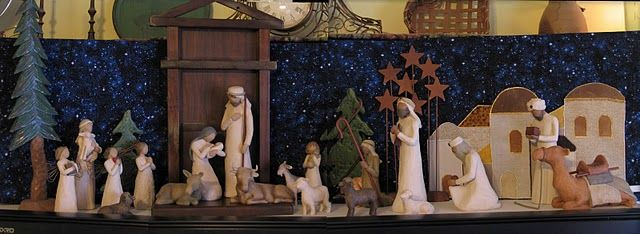a backdrop for Willow Tree Nativity set that consists of three envelope-like panels that stand up when a stiff piece of cardboard is inserted.