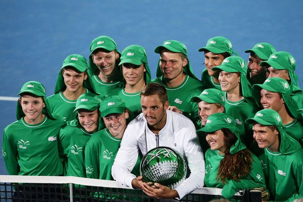 Viktor Troicki of Serbia poses with ball kids after winning the men's final match against Grigor Dimitrov of Bulgaria during day seven of the 2016 Sydney International at Sydney Olympic Park Tennis Centre on January 16, 2016 in Sydney, Australia.
