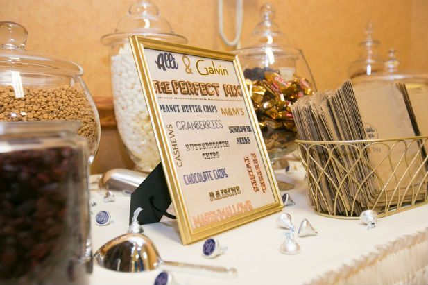 DIY trail mix bar for the reception featuring the couple's favorite additions