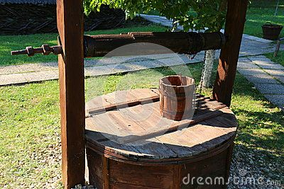 Old wooden bucket fountain - wooden bucket and lid.
