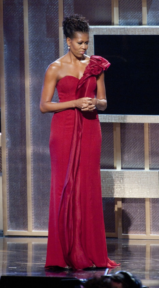 2012 - The First Lady attended the BET Honors to present an award to Maya Angelou in a scarlet organza one-shoulder J. Mendel gown.