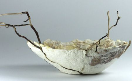 Judy Barrass - Not the Flat Surface. Raw pulp, printed on, re-pulped, formed into the shape of a boat with natural objects from the beach.