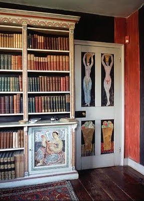 The library at Charleston. Door panels and bookcases decorated by Duncan Grant