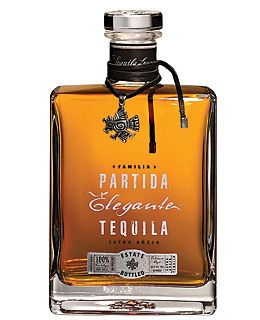 """""""Partida Tequila Elegante ($350) is the leader in a new trend of ultra-premium tequilas. Aged for more than three years in American oak, Elegante is made with 100% blue agave. And the bottle is as alluring as the spirits inside. Individually numbered, each one comes with a silver charm and crystal bottle top."""""""