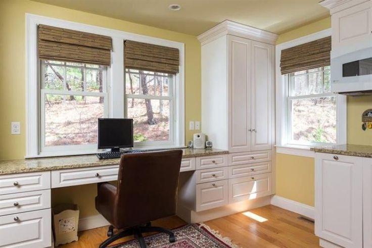 Traditional Home Office with Helvetica Desk Chair, High ceiling, Built-in bookshelf, Hardwood floors, Carpet