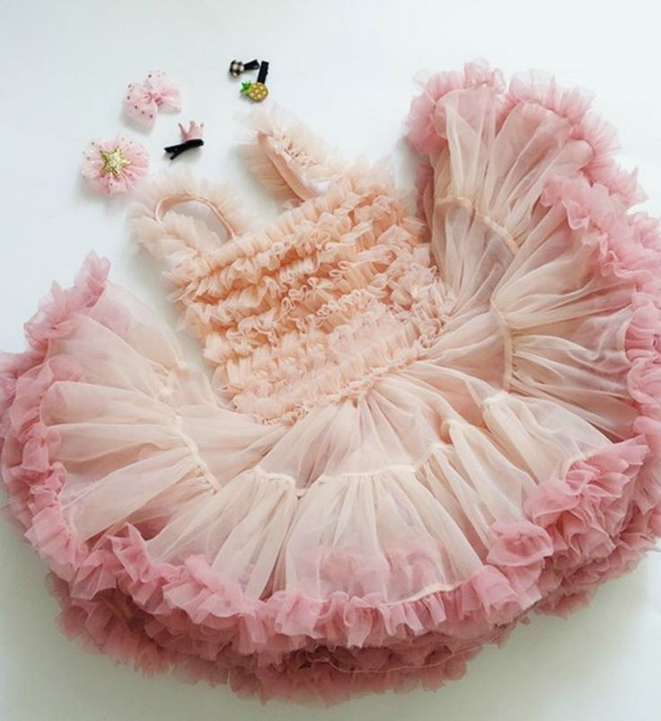 Rosette Tutu Dress--High Quality! Cute Super Soft & Fluffy Rosette Tutu Dress. Perfect for first birthday party, photo shoot or any occasion. Available from 9 months - 9 years. Material: Cotton, tulle mesh, chiffon. Color: Peach, Dusty Rose, Gray & Beige. Please do compare your little girl measurements with our size chart.