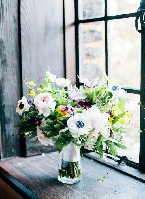 Anemone bridal bouquet with lavender, gold, blush, and white winter blooms