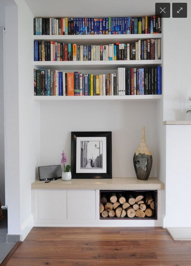 Living room- Shelving and cupboards arrangement. Preference is for hard wood shelves.