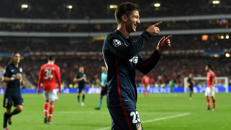 Luciano Vietto enjoys his 55th-minute goal though Kostas Mitroglou pulled one back as Atlético hung on for a 2-1 win and claimed top spot in Group C
