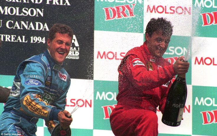 Despite his winning streak coming to an end at the previous race in Spain (he still finished second with just fifth gear) Schumacher was back on the top step in Montreal as he celebrates winning the Canadian Grand Prix alongside third-placed Jean Alesi of Ferrari