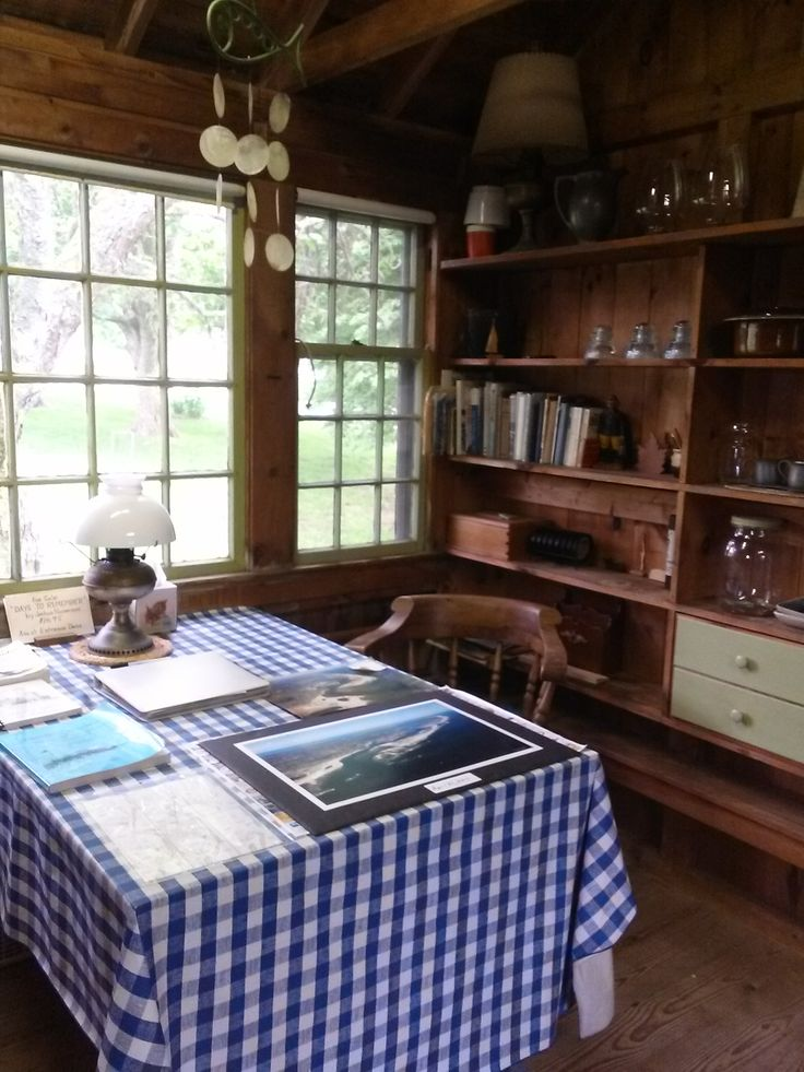 Photo taken 2014: Kitchen in the Nickerson North Beach Camp showing the table with information on the camp and north beach for visitors to the camp. #nickerson, #northbeachcamp, #northbeach, #camp, #beachcamp, #atwoodhouse, #chathamhistoricalsociety, #chatham, #capecod