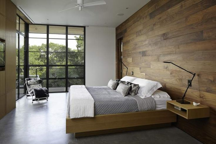 Walnut planks clad a feature wall in the master bedroom. (Brandpoint)