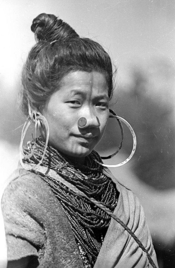 India | This Apatani woman is Tage Yaring, the fourth wife of Ponyo Tamar, an influential man in Hong Village, Apatani valley, Lower Subansiri District.  ca. 1944 | © Nicholas Fürer-Haimendorf