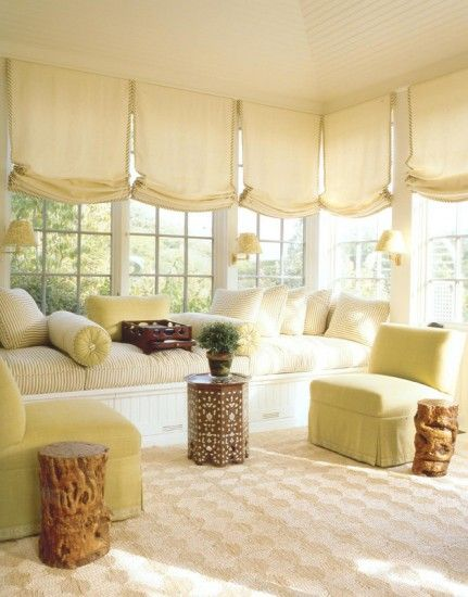 Love this put together sunroom.  The built-in long daybed could serve as extra sleeping space for guests.