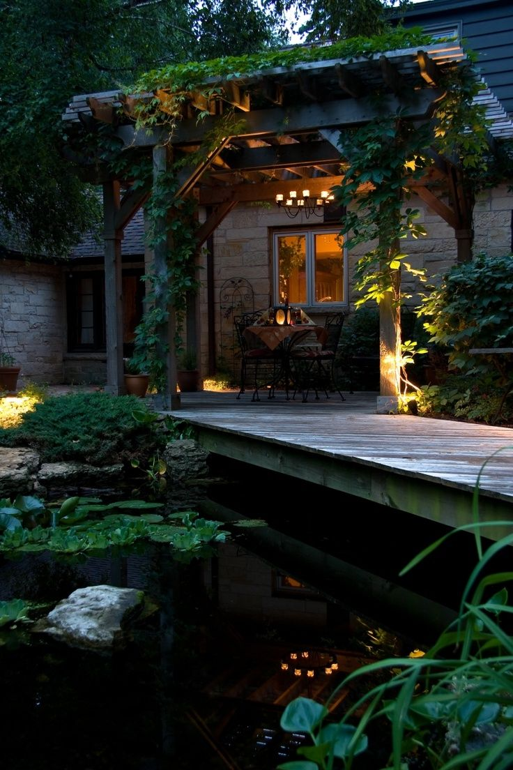 Pond and pergola with candles and beautiful light.