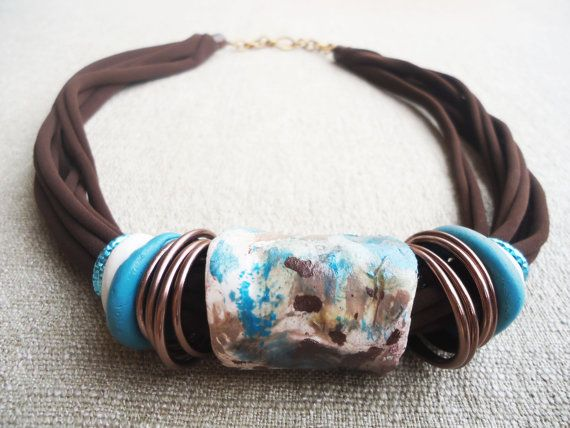 Turquoise, chocolate and bronze.... Handmade with clay hand molded and Painted..