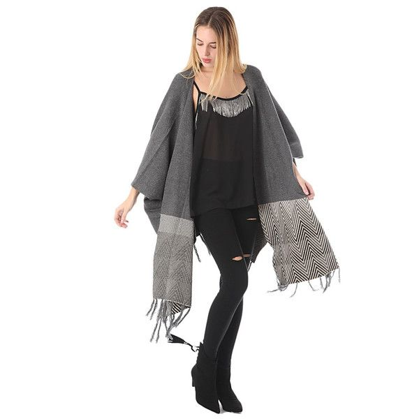 Layer up in style with this mixed knit cape. The different textures and tribal print hemdetail makes this a wardrobe staple. Just throw-on-and-go for casual ch
