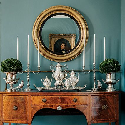 Love the Antique Buffet Laiden With Sterling Silver, Round Mirror (hung a little too high), Sumptuous Teal Wall Colour - Garden and Gun | Soul of the South