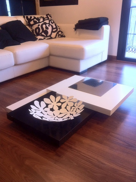 custom coffee table from multiple Ikea lack tables -- Interesting idea... maybe I could work something for my walls like this.