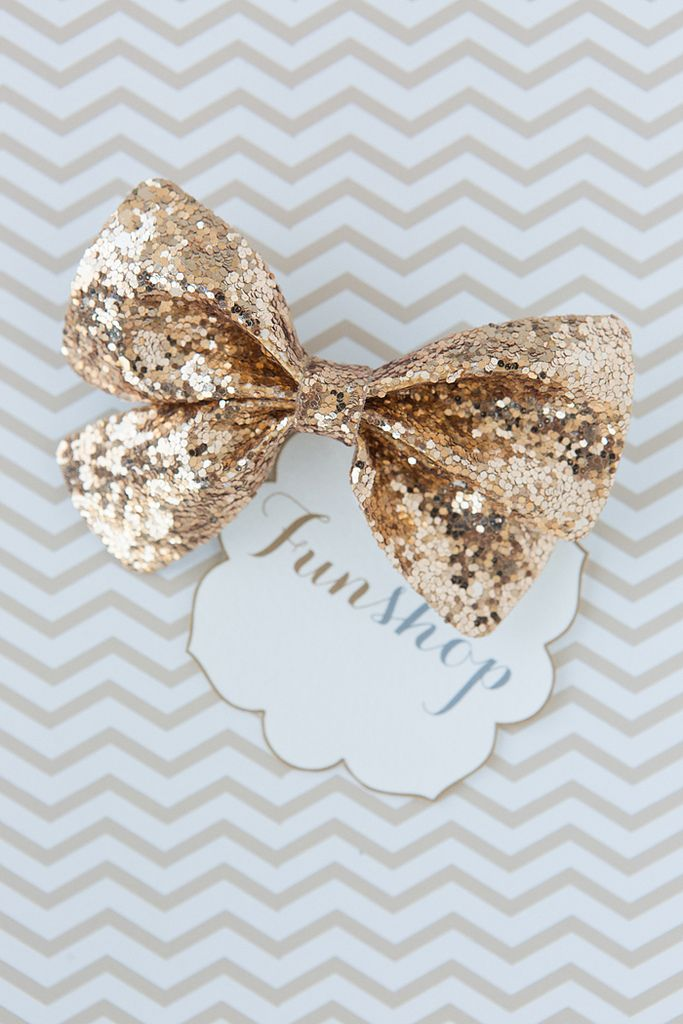 gold glitter bow Not instructions for DIY but its easy if you get the fabric... Then look up videos on how to make the bow