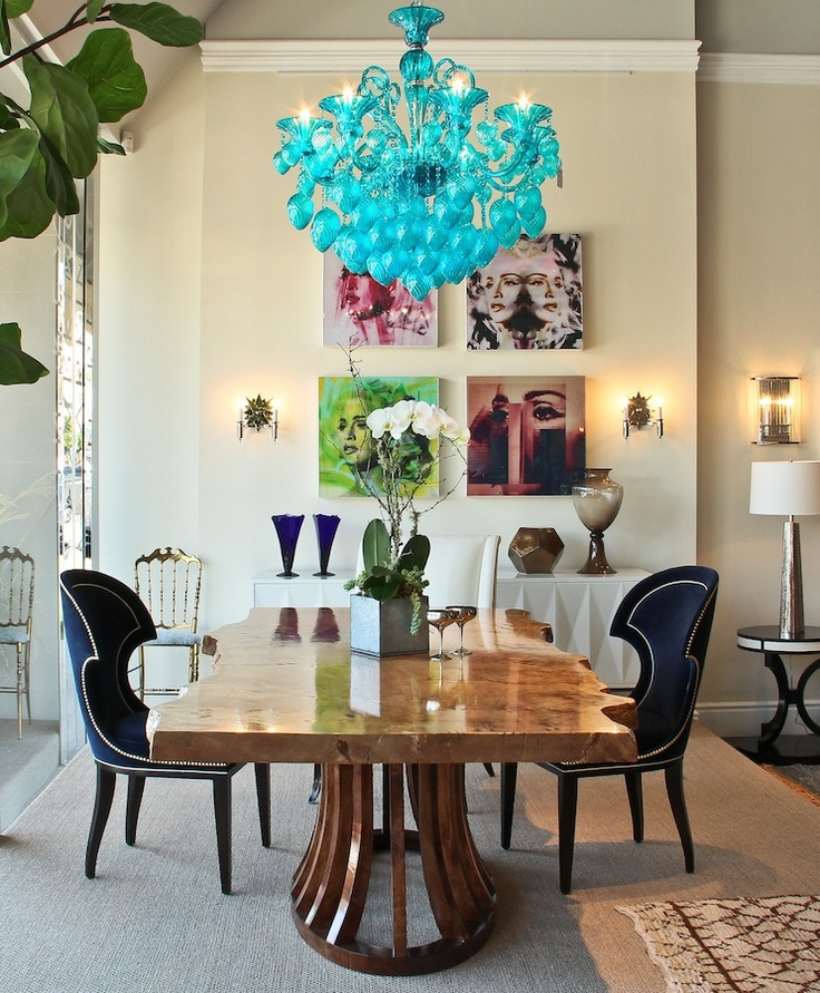 really creative interesting dining room love that blue chandelier timber table and upholstered black chairs gorgeous art too