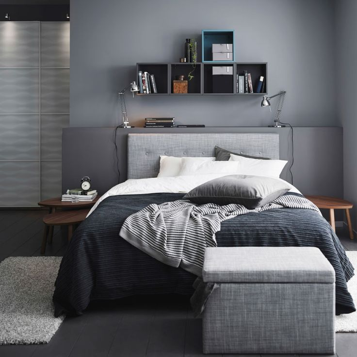 A grey bedroom with a grey ÅRVIKSAND divan bed, a grey TUSENSKÖNA bed spread and a ...