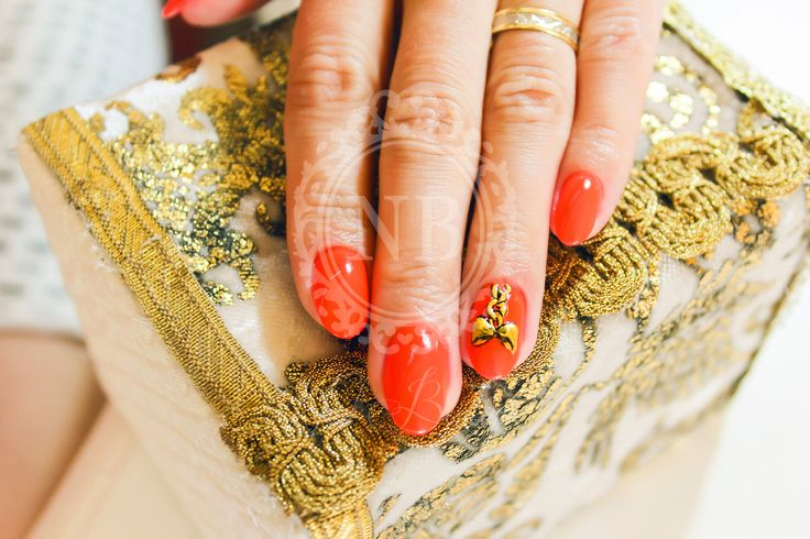 Red nails and beautiful bow